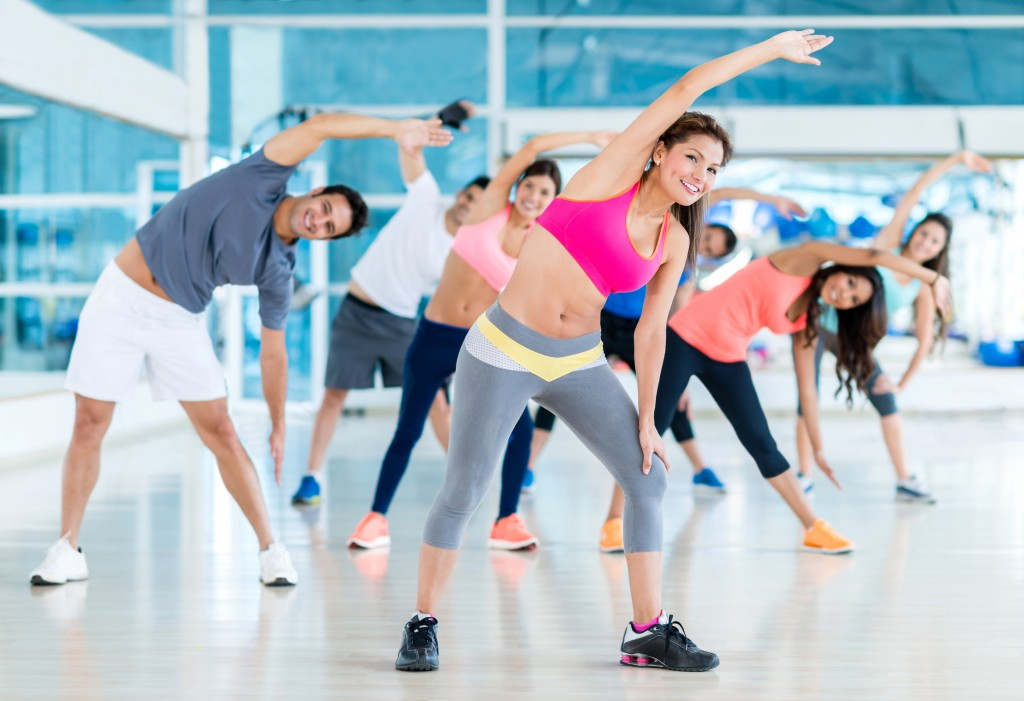 Group of gym people in a stretching class
