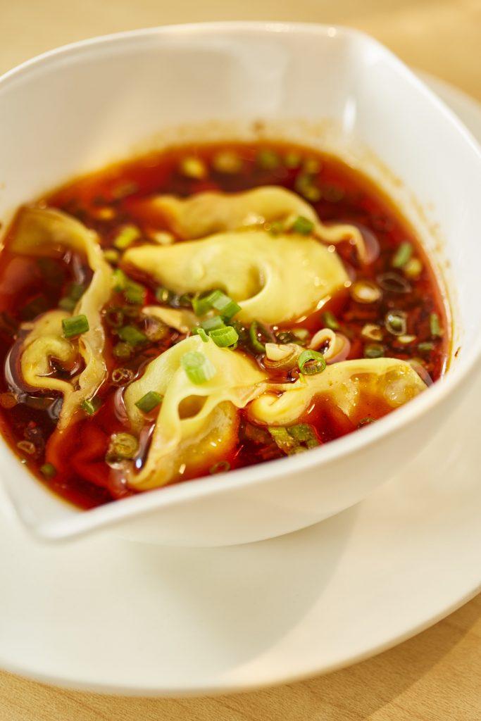 Dumplings in Szechuan Sauce
